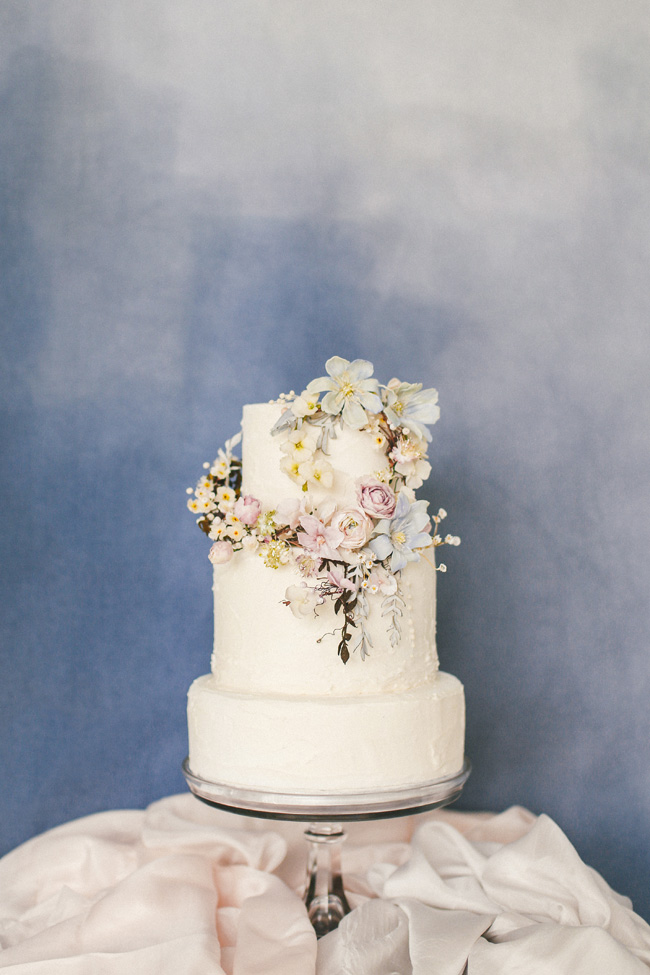 Paper magnolias, calligraphy and dusky blue ethereal beauty - bridal inspo by Jess Petrie Photography (8)