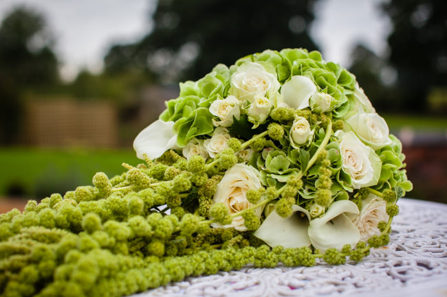 Gold styling accents and a fabulously tumbling green bouquet - Charlotte Giddings Photography (5)
