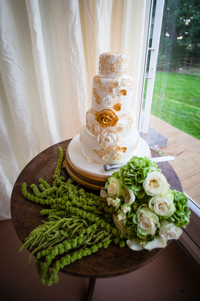 Gold styling accents and a fabulously tumbling green bouquet - Charlotte Giddings Photography (19)