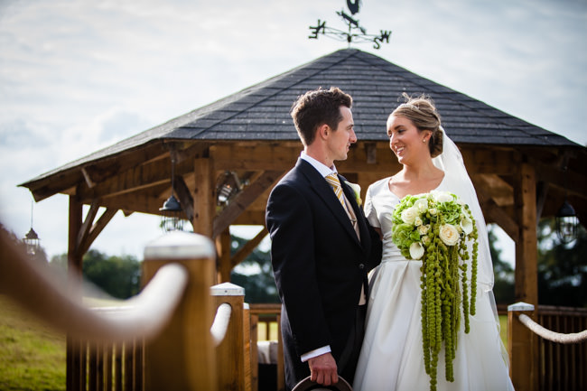 Gold styling accents and a fabulously tumbling green bouquet - Charlotte Giddings Photography (24)