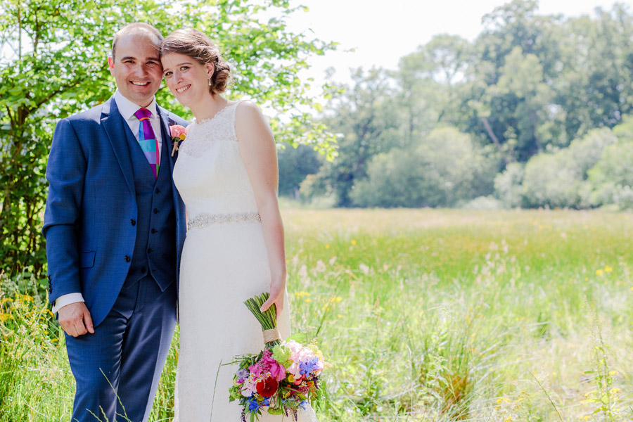 Vibrant florals at Millbridge Court, with Stylish Wedding Photography (14)