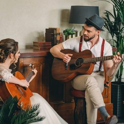 Making music together… romantic guitar and vintage pub wedding editorial