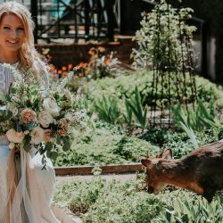 Beautiful barn wedding editorial with a refined peach palette – and a photo-bombing tame deer!
