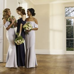 Who should pay for the bridesmaids' dresses and how much should they cost?