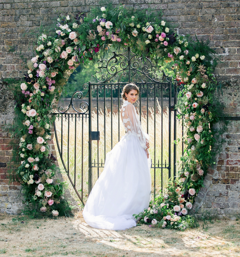Stunning florals and archway flower surround for a breathtaking wedding style article on English Wedding, image credit Lisa Payne Photography (25)