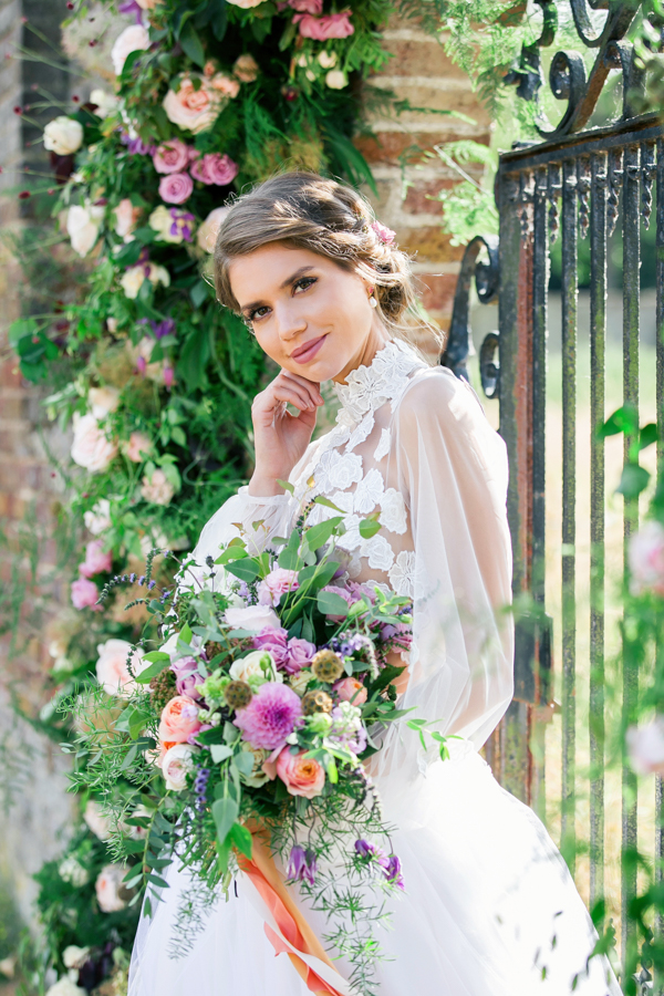 Stunning florals and archway flower surround for a breathtaking wedding style article on English Wedding, image credit Lisa Payne Photography (26)