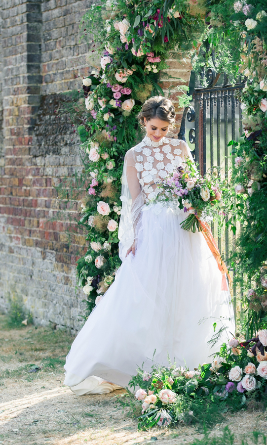 Stunning florals and archway flower surround for a breathtaking wedding style article on English Wedding, image credit Lisa Payne Photography (28)
