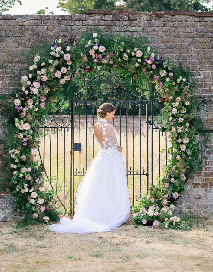 Stunning florals and archway flower surround for a breathtaking wedding style article on English Wedding, image credit Lisa Payne Photography (29)