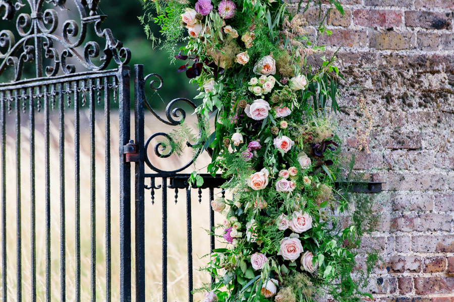 Stunning florals and archway flower surround for a breathtaking wedding style article on English Wedding, image credit Lisa Payne Photography (36)