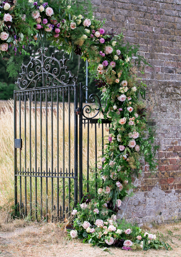 Stunning florals and archway flower surround for a breathtaking wedding style article on English Wedding, image credit Lisa Payne Photography (37)