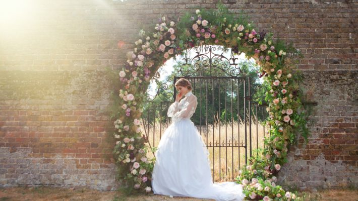 Stunning florals and archway flower surround for a breathtaking wedding style article on English Wedding, image credit Lisa Payne Photography (38)