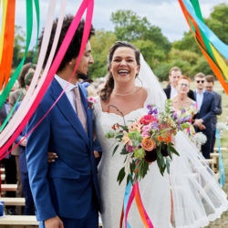 Sophie and Loz's colourful festival wedding, with Simon Withyman Photography