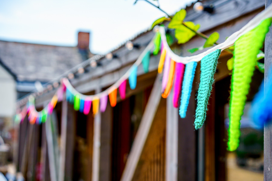 Colourful bunting for a summer wedding at River Cottage, images by Spencer White Photography (15)