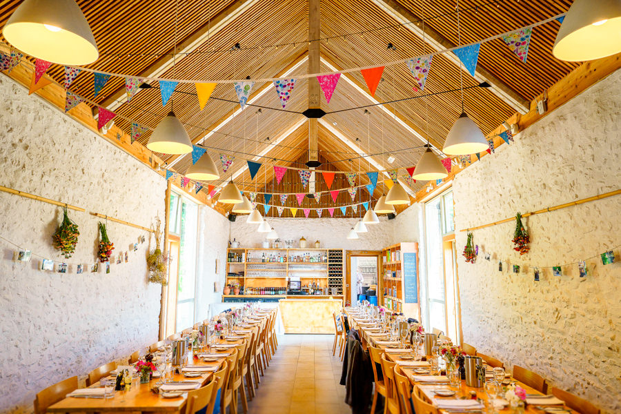 Colourful bunting for a summer wedding at River Cottage, images by Spencer White Photography (30)