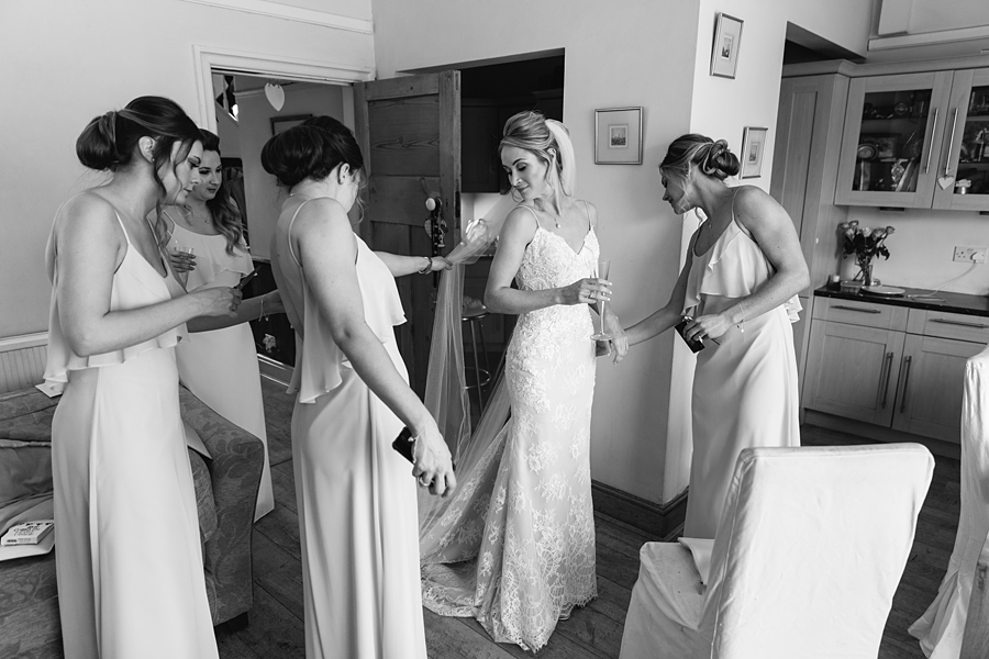 Pastel blue bridesmaids for a winter wedding in Mobberley, photo by Tony Fanning (10)
