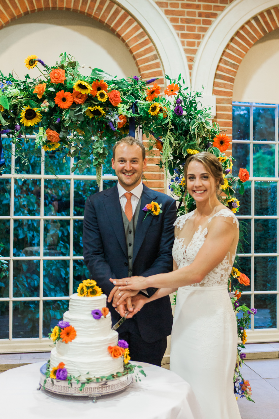 Sunflowers, roses and a beautiful backless wedding dress for this gorgeous Great Fosters wedding. Images by Amanda Karen Photography (42)