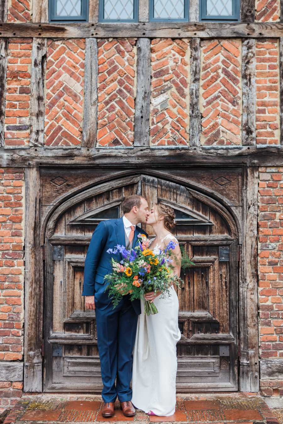 Sunflowers, roses and a beautiful backless wedding dress for this gorgeous Great Fosters wedding. Images by Amanda Karen Photography (21)