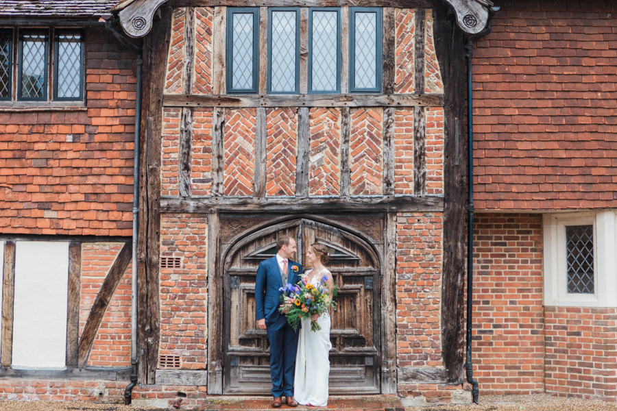 Sunflowers, roses and a beautiful backless wedding dress for this gorgeous Great Fosters wedding. Images by Amanda Karen Photography (22)