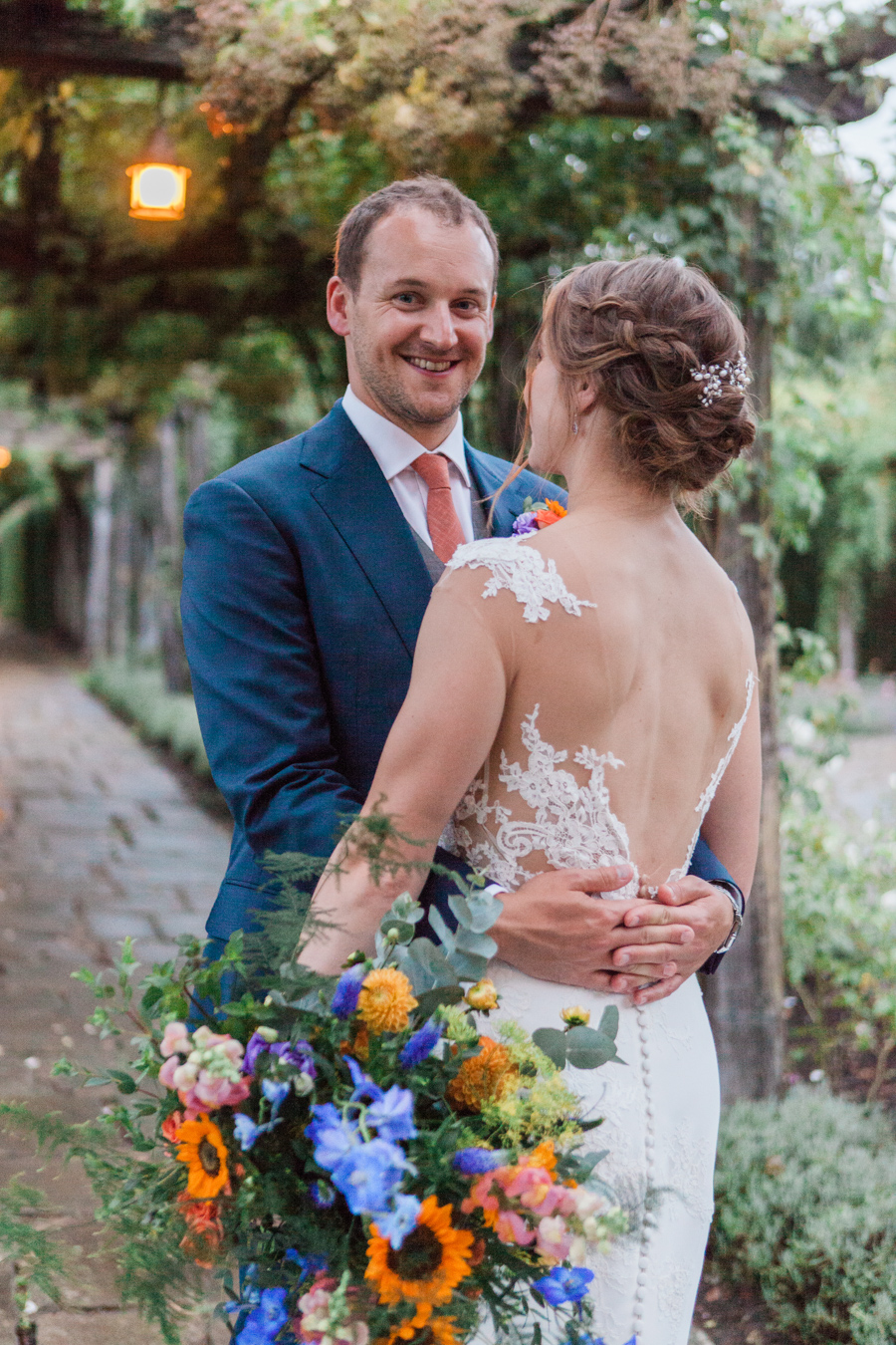 Sunflowers, roses and a beautiful backless wedding dress for this gorgeous Great Fosters wedding. Images by Amanda Karen Photography (27)