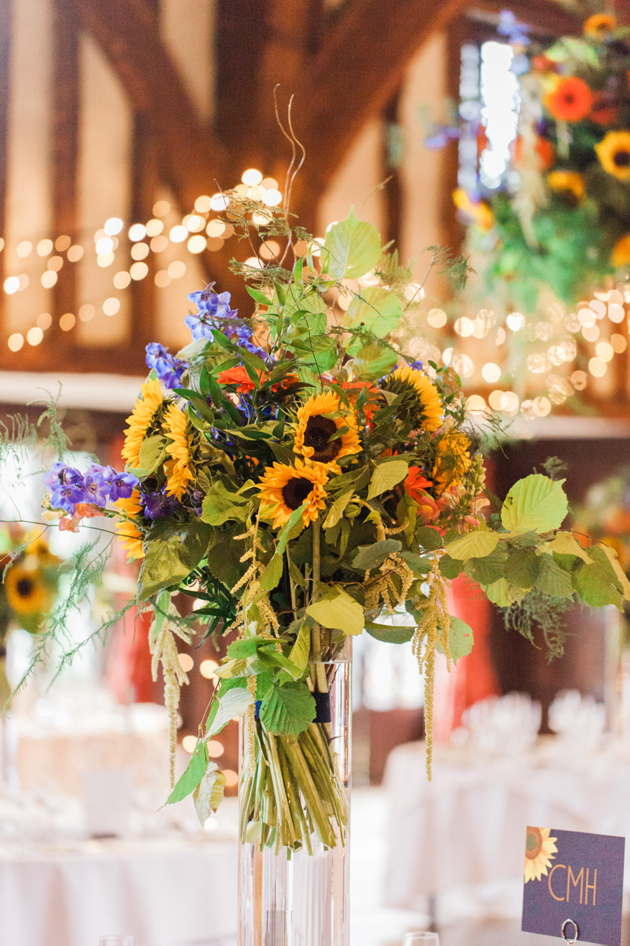 Sunflowers, roses and a beautiful backless wedding dress for this gorgeous Great Fosters wedding. Images by Amanda Karen Photography (34)