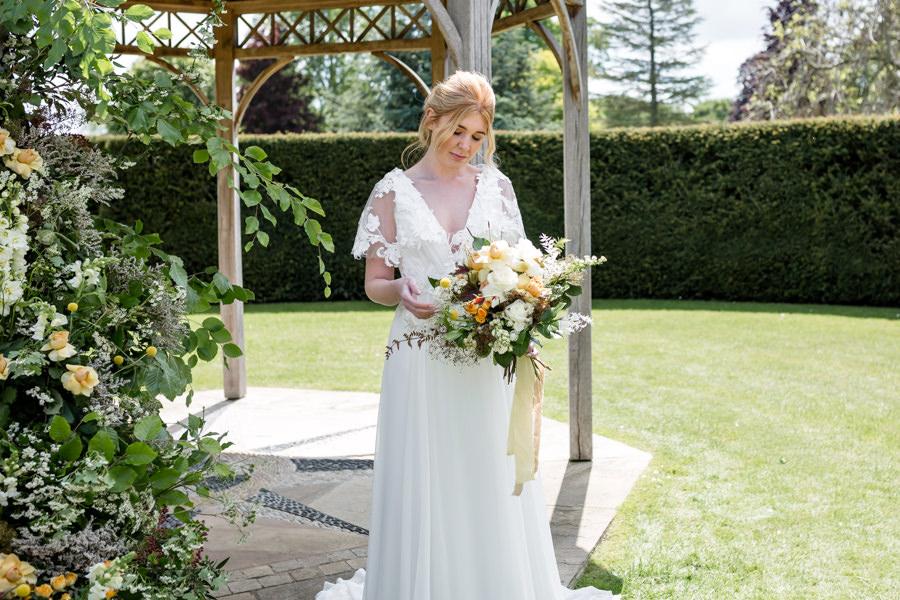 Boho luxe wedding style with soft orange and muted tones at Chippenham, image credit Heather Jackson Photography (11)