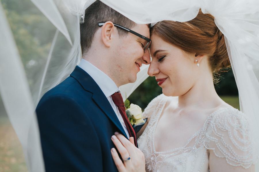 Philippa and Mark's Gatsby wedding at Holmewood Hall Cambridgeshire