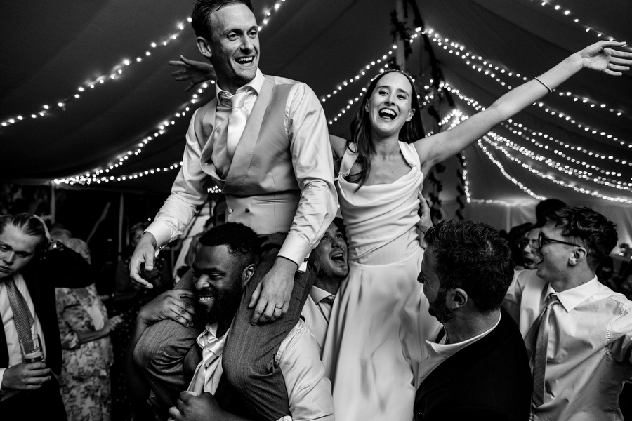 Tess and Tom at their marquee wedding in Swallowfied by Richard Skins Photography
