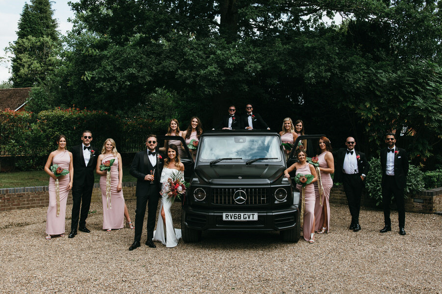 Bridal party group shot with a Mercedes G-Wagon by Simon Biffen Photography