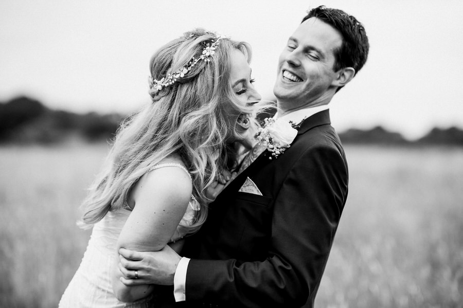 Big laughs from Keely and Luke on their wedding day