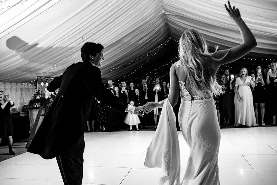 bride and groom enter the room for their first dance, image by Simon Biffen Photography