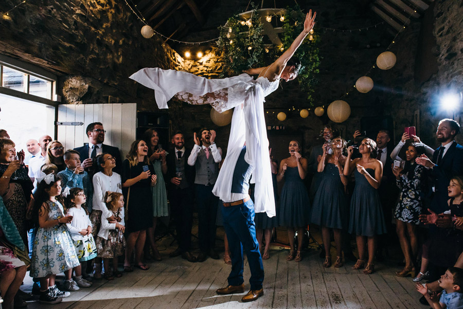 groom epic lift of bride during first dance, image by Simon Biffen Photography