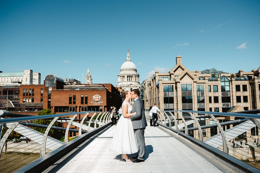 Bride and Groom on Millenium Bridge, captured by Fiona Kelly Photography