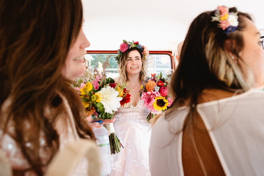 Bride and bridesmaids on the way to the wedding, captured by Fiona Kelly Photography
