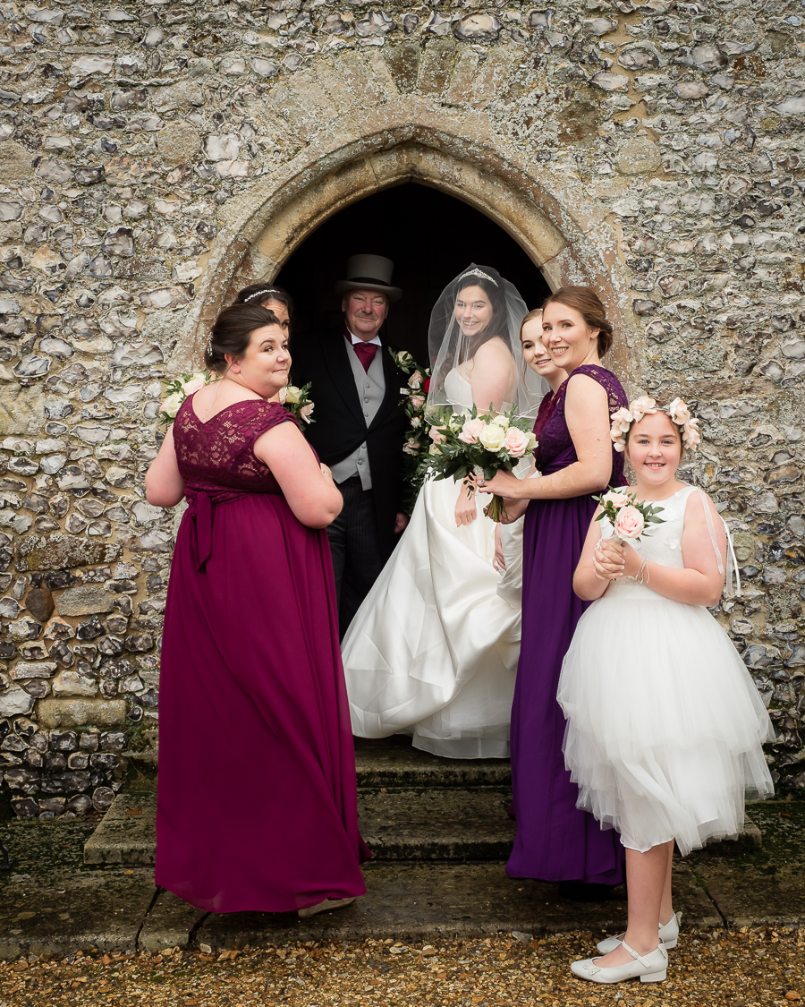 Emma, her father and bridesmaids at her Wiltshire country church wedding - Dom Brenton Photography