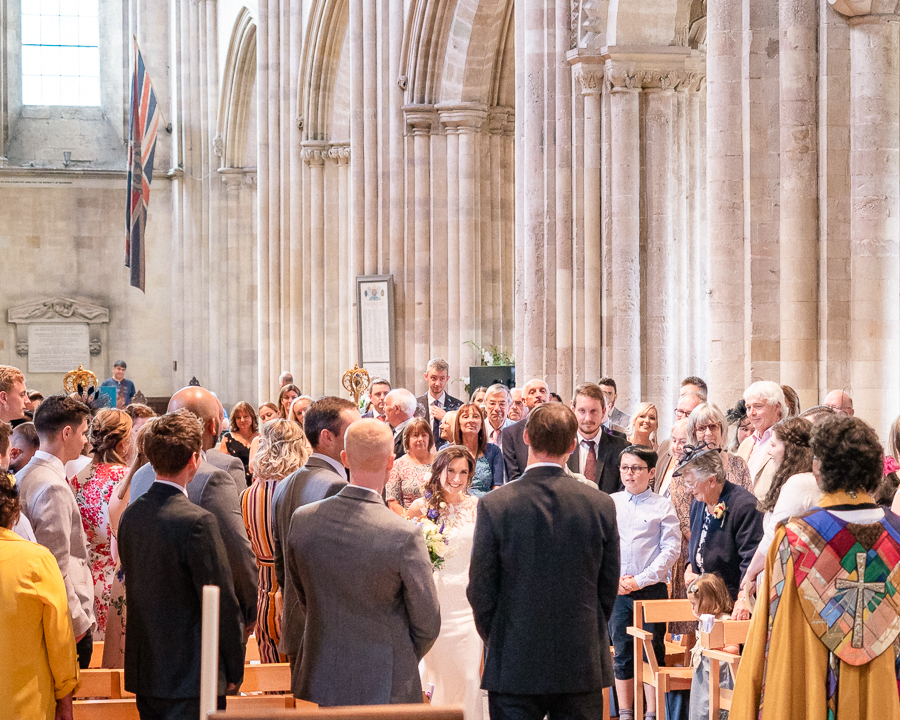 Laura greets Nicolas at the start of their wedding in Romsey Abbey - Dom Brenton Photography
