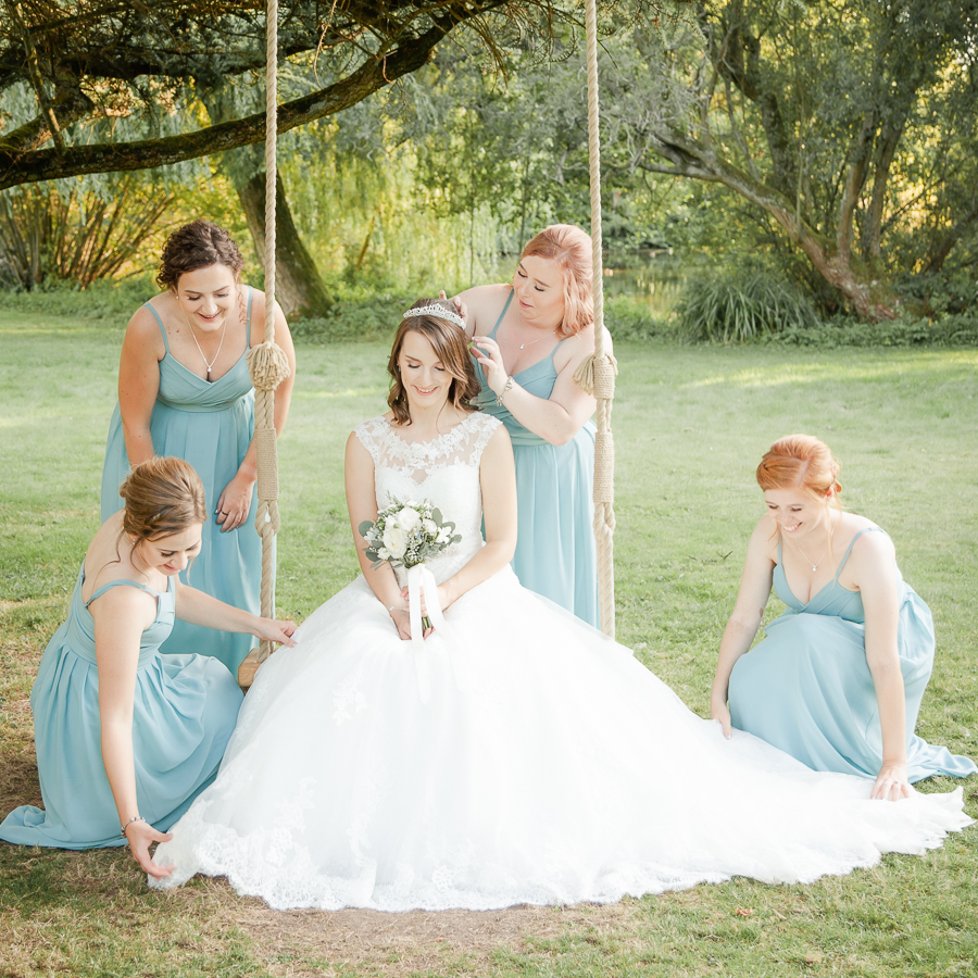 Leanne attended by her bridesmaids at Norton Park, near Winchester - Dom Brenton Photography