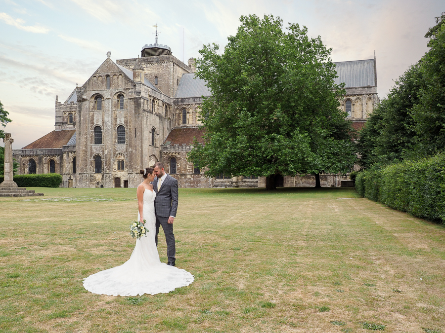 Romantic portrait of Emma and Aaron outside Romsey Abbey - Dom Brenton Photography