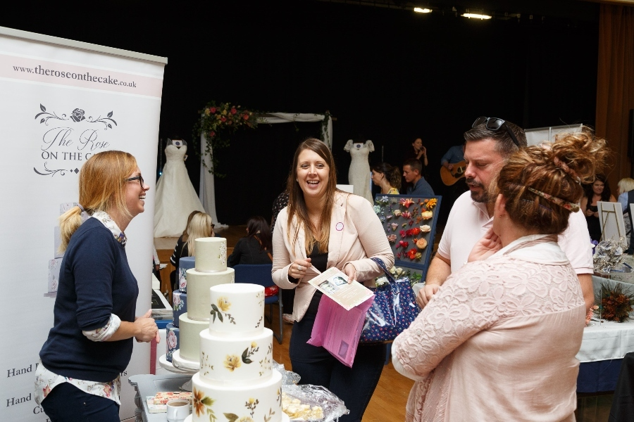 Happy Couple & Exhibitor at Dorset & Somerset Wedding Show by The Wedding Scene