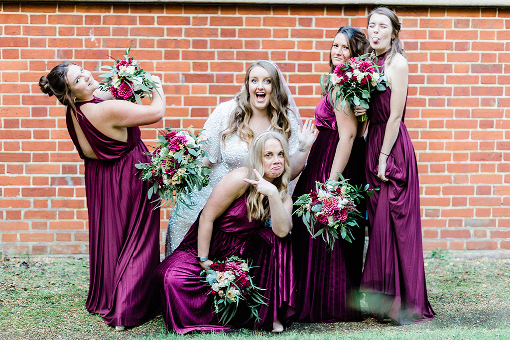 Bridesmaids and bride posing for quirky photo, Queen Bea Photography