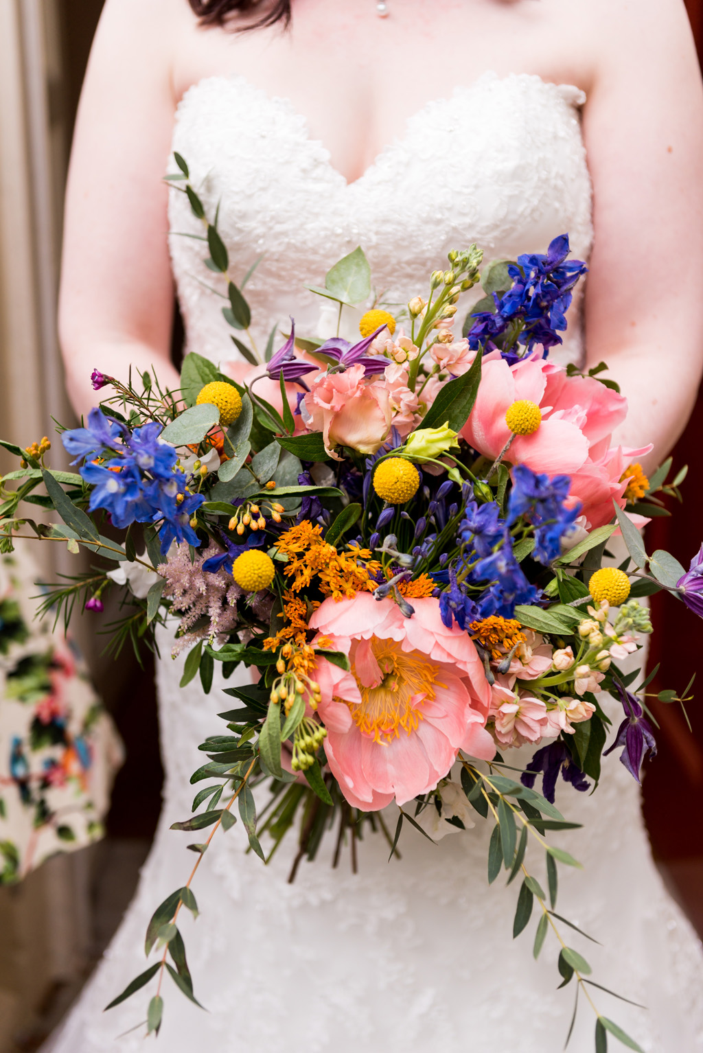 Colourful wedding bouquet with peonies and delphiniums