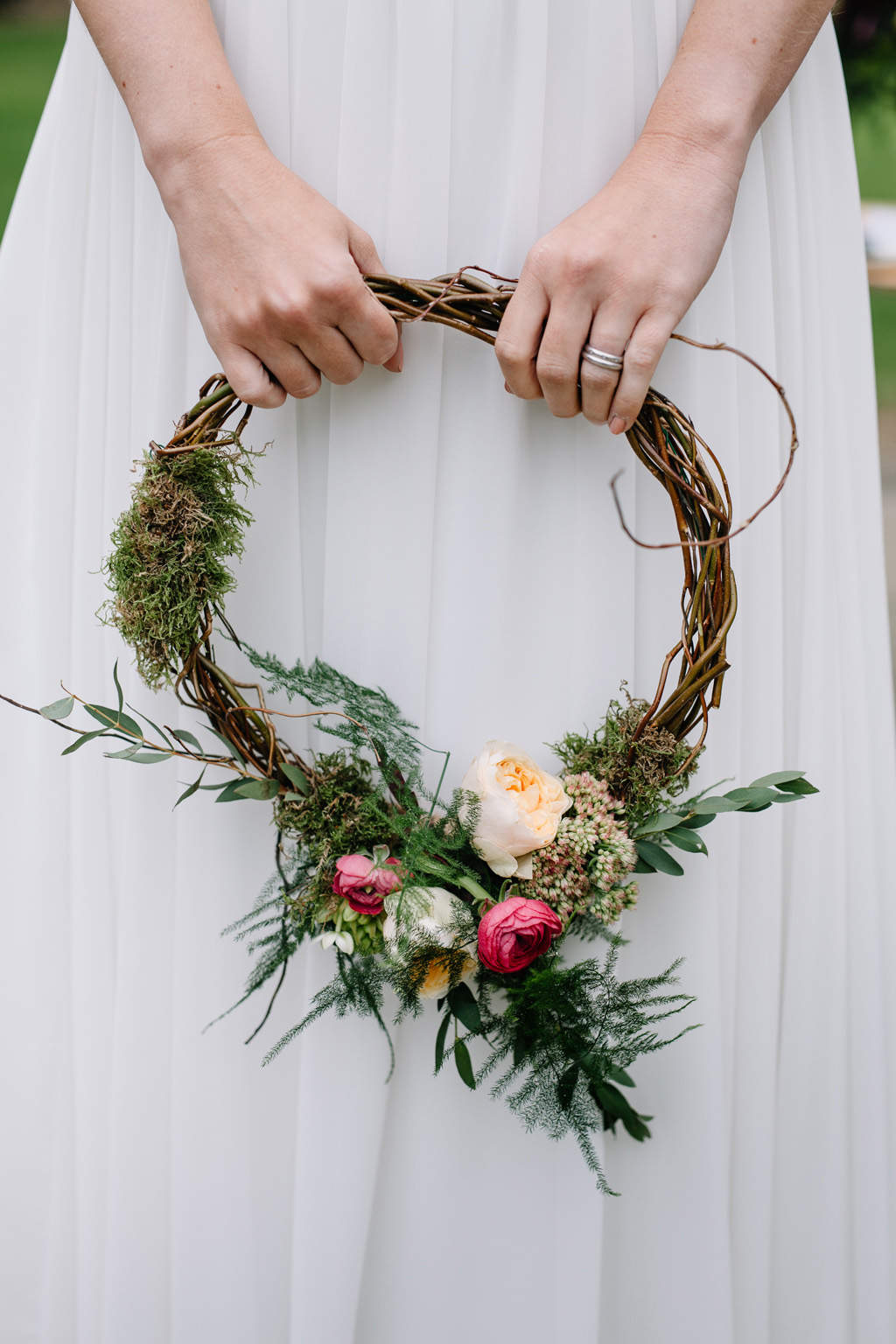 twisted willow bridal hoop in a boho style with moss, roses and peonies
