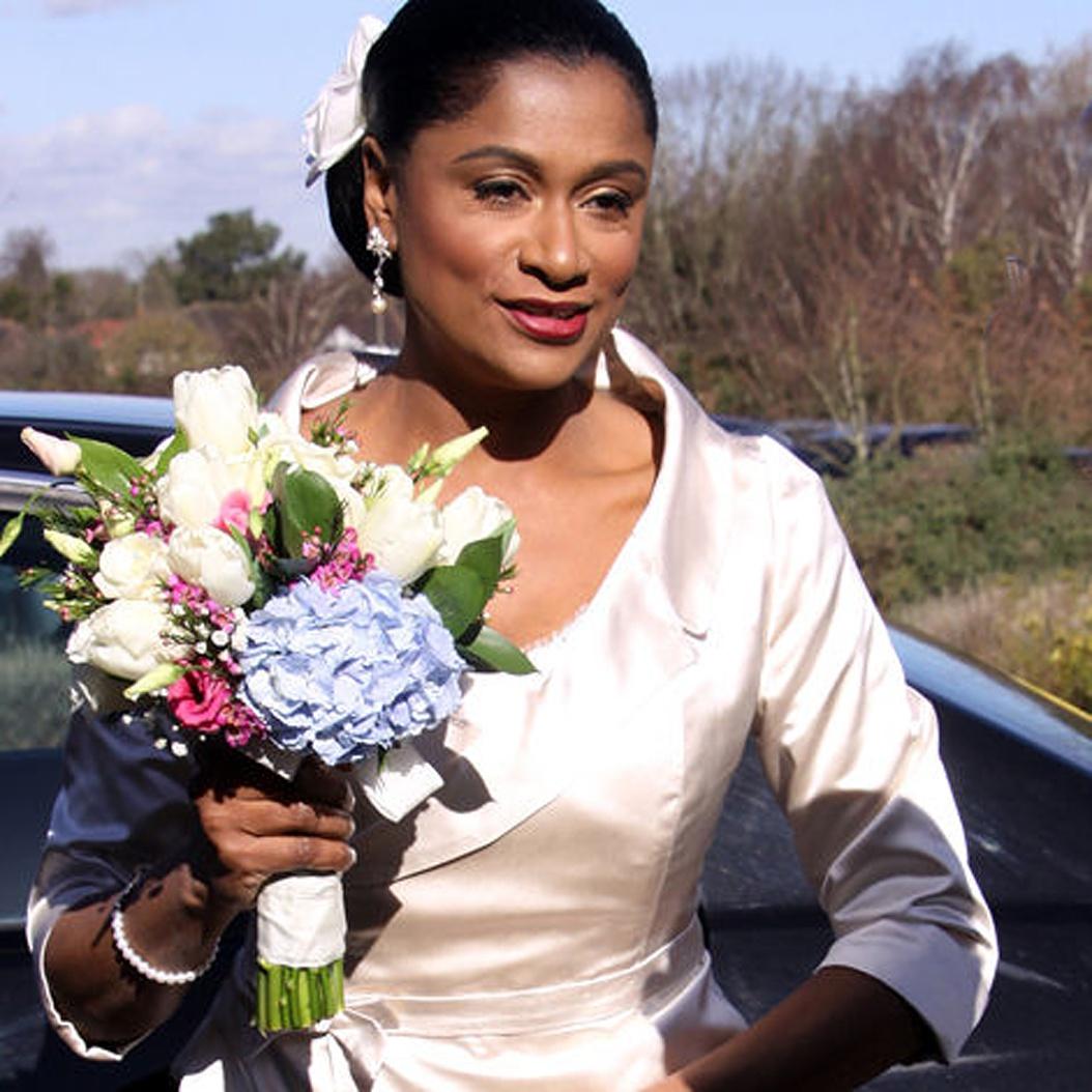 An alternative wedding dress of blush silk satin jacket for a modern mature black bride by felicity westmacott. Image credit Crystal Wiggins Photography