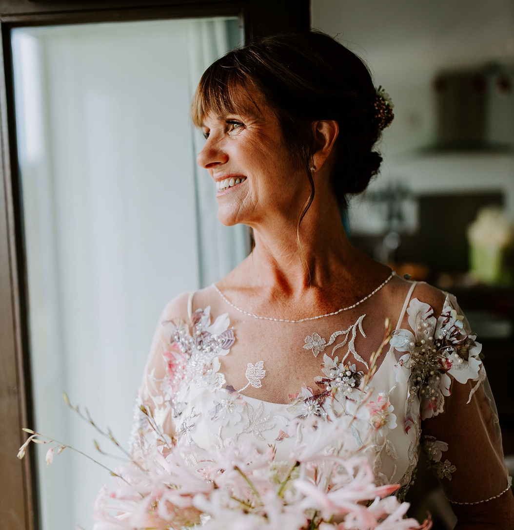 Contempory and classic dress for an older bride with hand beaded detail by Felicity Westmacott. Photographer credit Thomas Frost Photography
