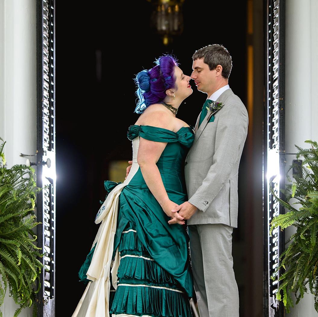 Historical inspired victorian wedding dress in green silk for an alternative bride by Felicity Westmacott. Image credit Yuriy Nutsa