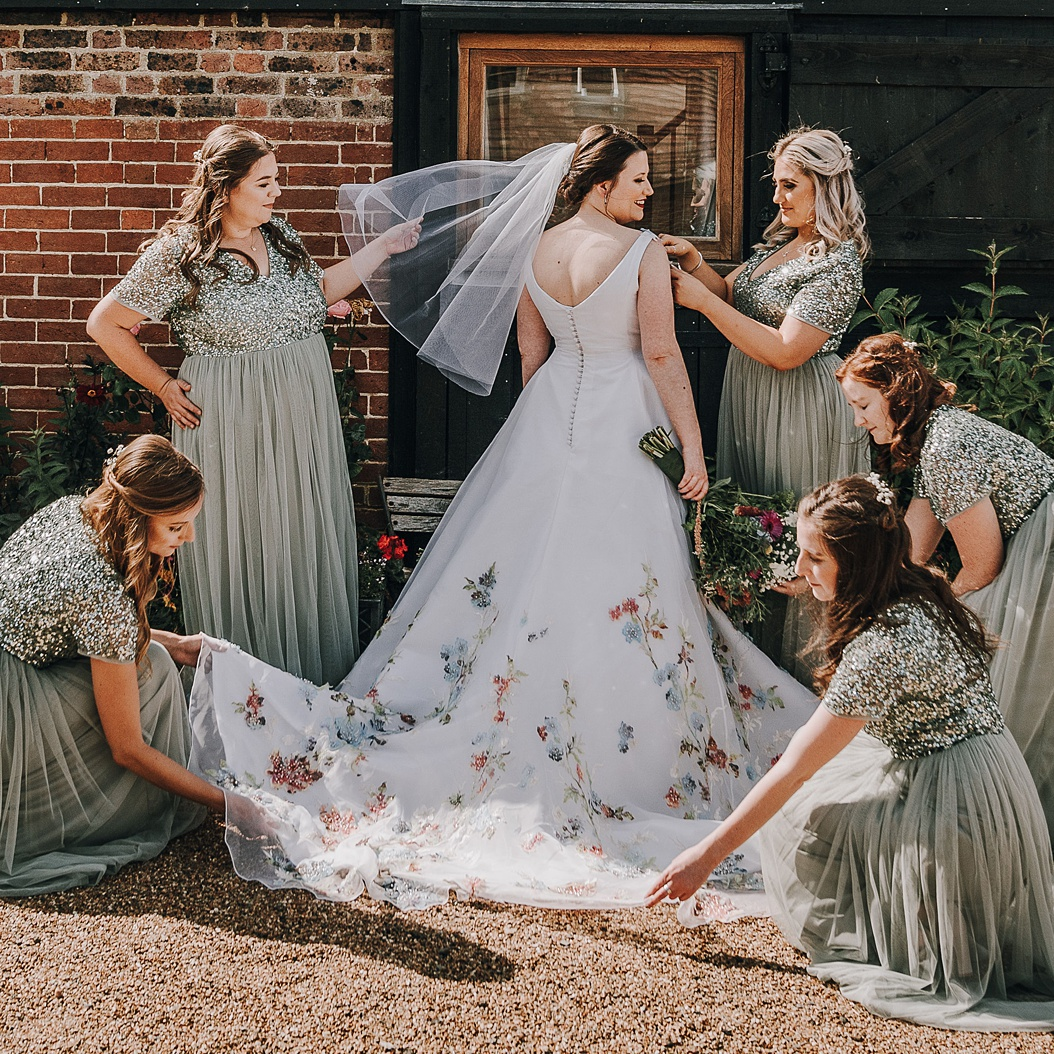 Pretty hand painted silk and floral wedding dress by Felicity Westmacott, photographer credit DM Photography