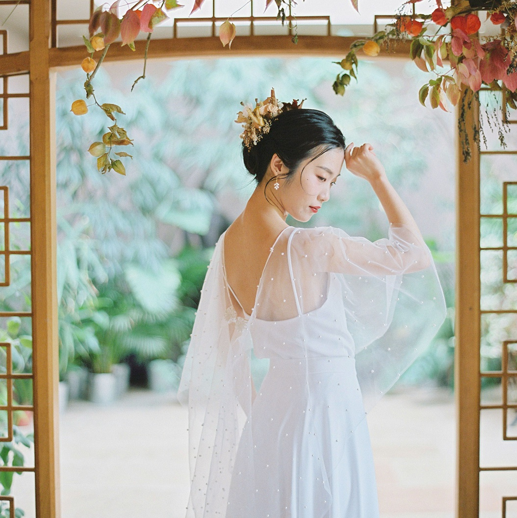 Simple and elegant wedding dress separates in matt crepe with cape by Felicity Westmacott. Image credit Terry Li Photography