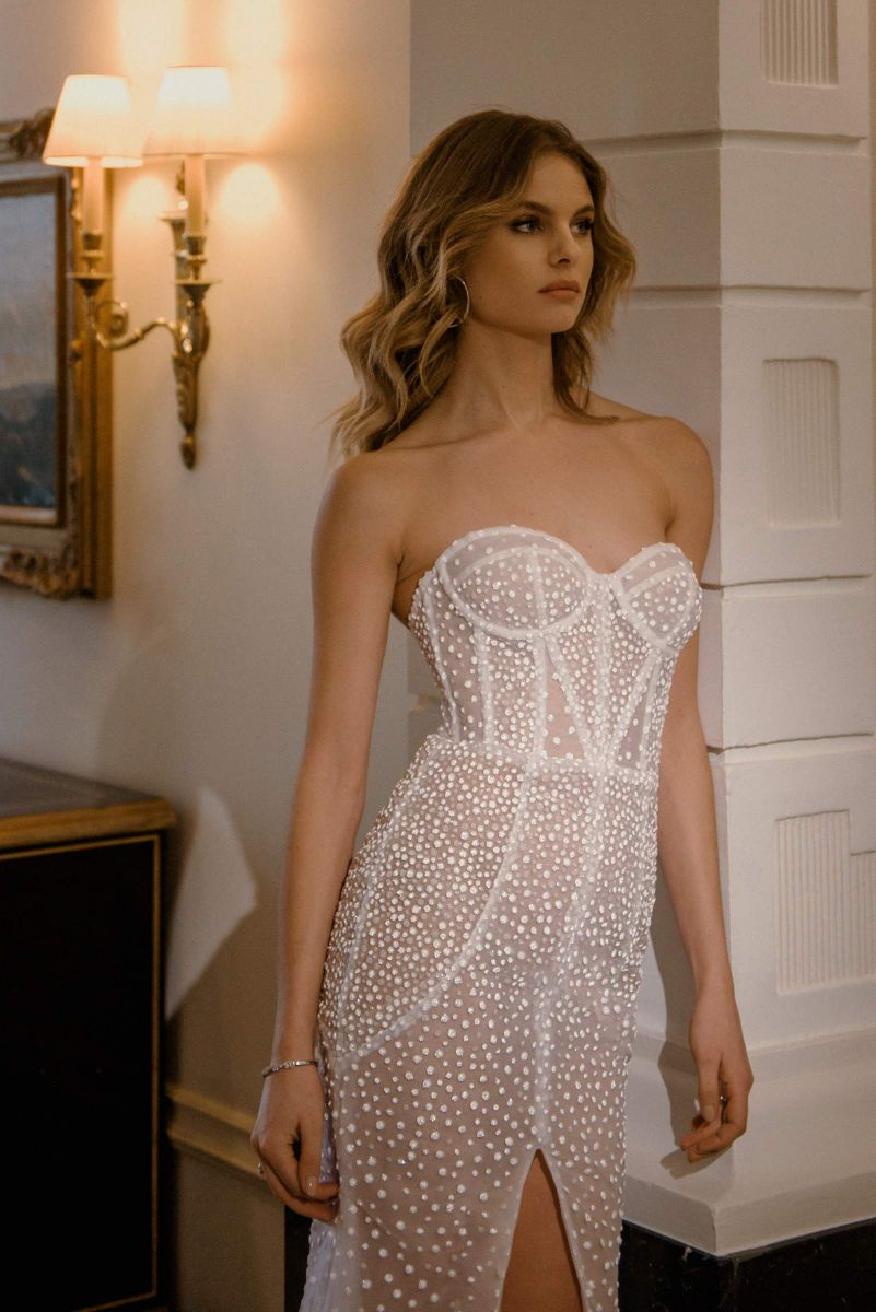 Perry gown by Karin Rom Bridal, striking structure and delicate detail for a bold statement gown