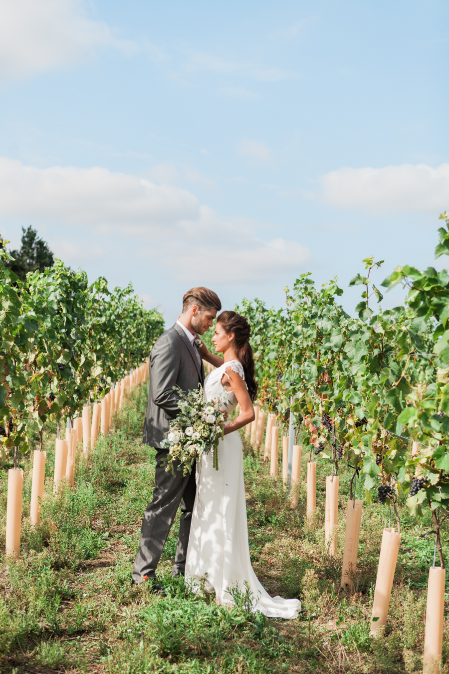 Norfolk wedding inspiration with tumbling green foliage, olive branch styling and a bride and groom in relaxed casual outfits, image credit Amanda Karen Photography