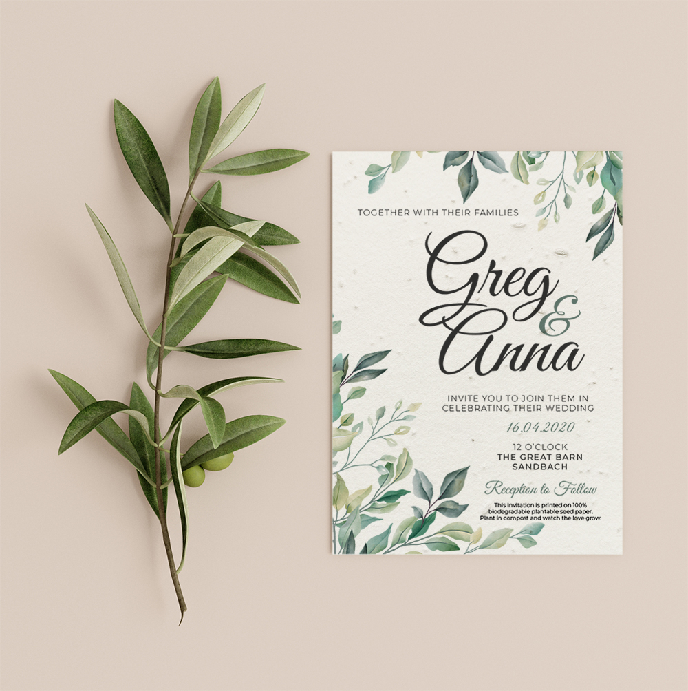 Greenery invitation by Little Green Wedding with leaf detail in top right and bottom left corners