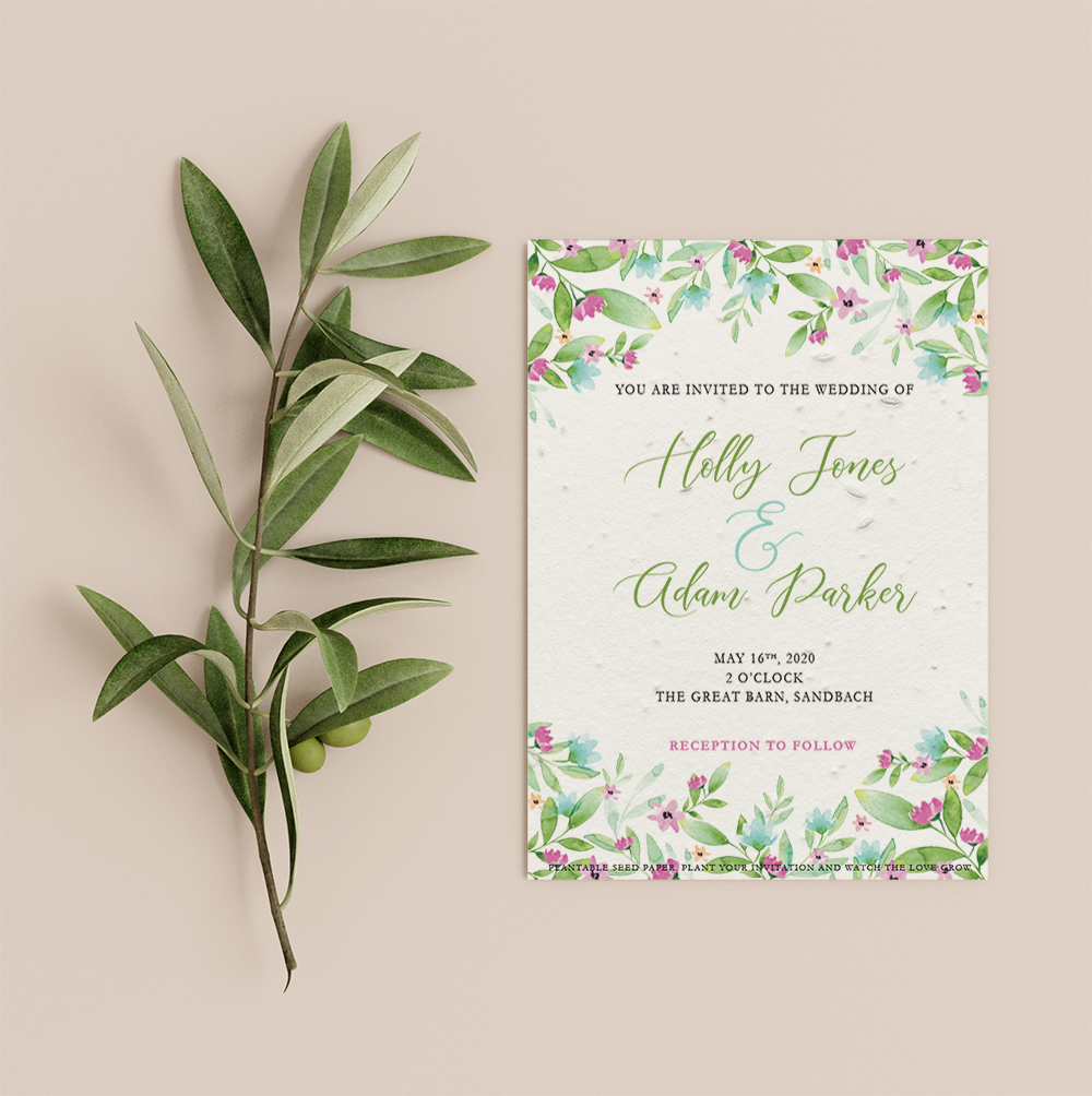 Spring wedding invitation by Little Green Wedding with bright flowers and foliage at top and bottom